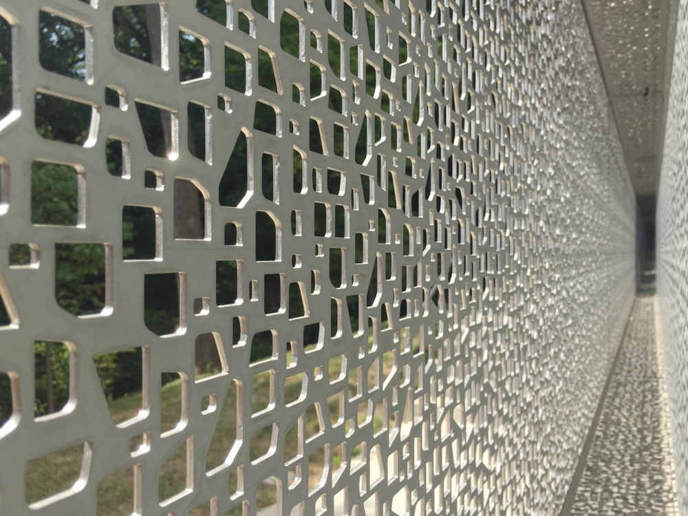 Visual Art Building's punched exterior sun screen