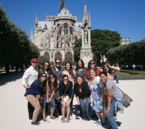 Students pose for a group photo in front of a cathedral in Spain