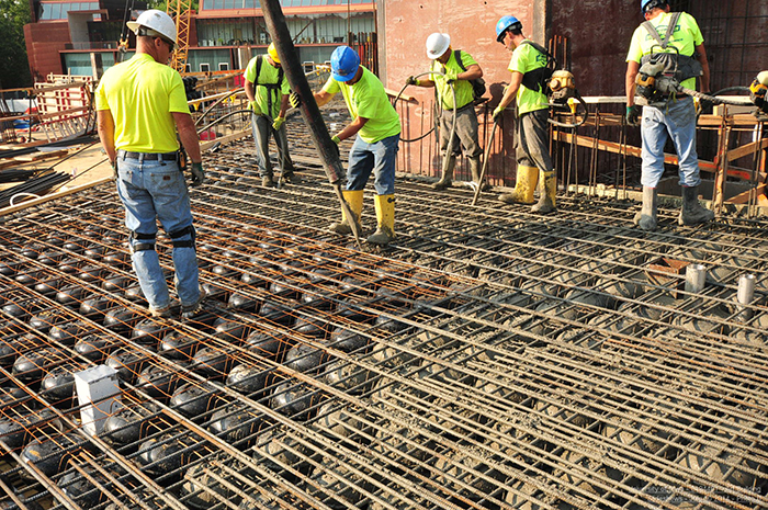 "Workers pour concrete of PEX tubing and Cobiax ""bubbles"""