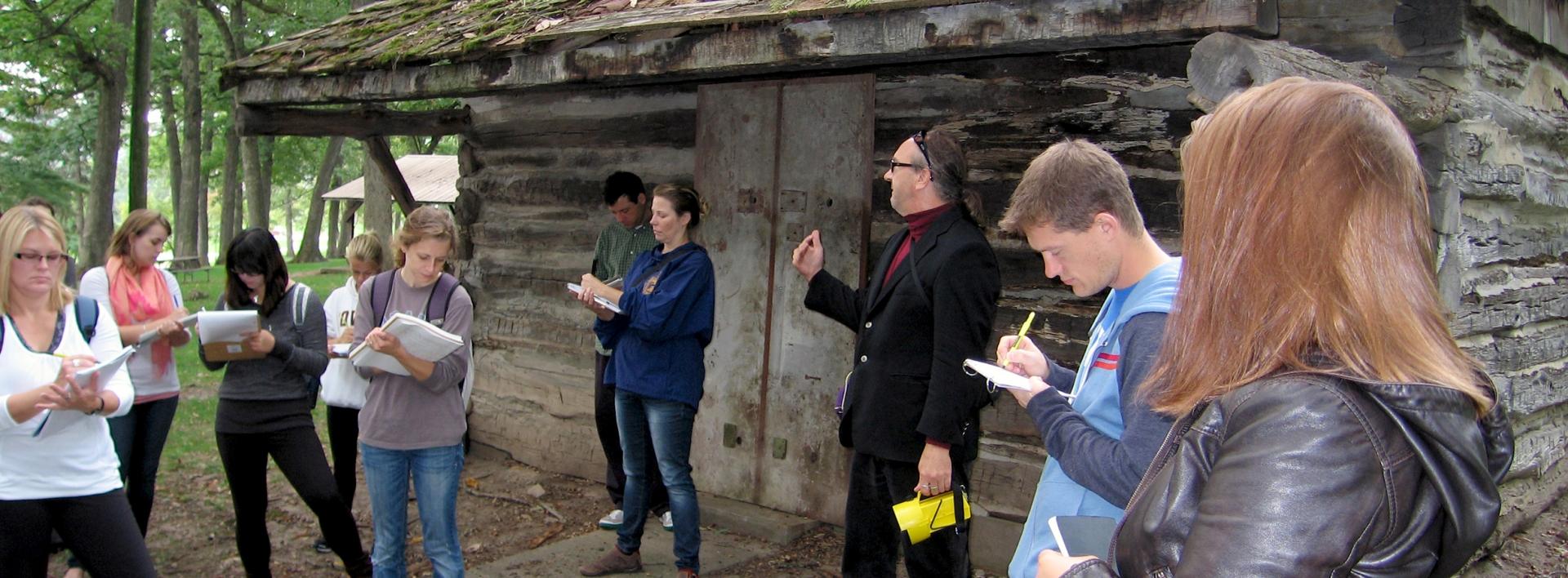 Art students at an iowa log cabin field trip