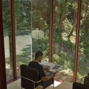 Quiet study area with view of the wooded hillside next to the pond.