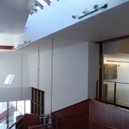 View of the third floor landing with the main stair and skylights.