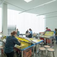 Students making art in the silkscreen studio