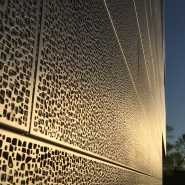 Detail of exterior punched stainless steel panels.