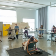 Life drawing class in a studio filled with natural light