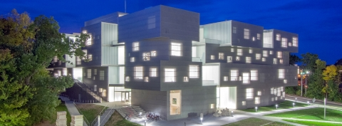 Exterior view at night of the new Visual Arts Building at the University of Iowa.