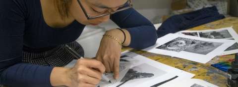 An art student working on some sketches.