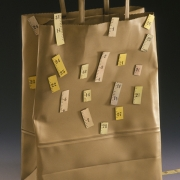 "Sculpture     1999 ""Bag-gage #4: Been measured, being measured, will be measured.""  Brass, acrylic paint and laser printer ink."