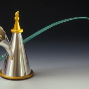 "Teapot 	2004 Gold, silver, anodized aluminum and cork.  13.4"" (L) x 3.9"" (W) x 7.3"" (H)."