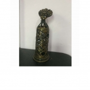 Akuba doll candle stand in brass with an oxidized finish