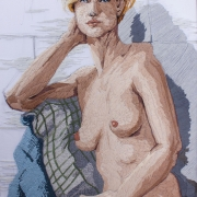 A woman with short hair seated on a chair covered with blankets. Made completely of stitches.