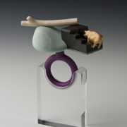 "Ring        2013 ""Time out""  Gold plated silver, bronze, anodized aluminum, bird eye maple wood, graphite, and rock.  3""(L) x 2."