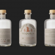 bottles with wood tops text on labels