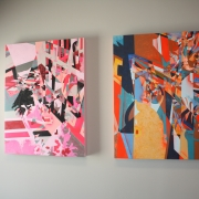 two multicolored paintings hung on a wall