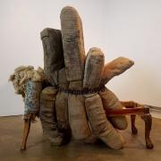 wood frame, black coil, cushions
