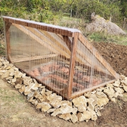 rocks, wood frame, clear corrugated material